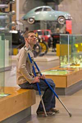 visually impaired man seated in museum